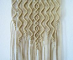 """Macrame wall hanging - Algae - unique and stylish wall decor for your home or office. Handmade, original idea and design by Evgenia Garcia. Color: jute Sizes: Dowel width – 12 (30.5 cm) Width of weaving about 9 (23 cm) Panel height from dowel to longest end – 46"""" (117 cm) Cord diameter 2"""