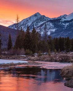 """Rocky Mountain National Park's west side is a great place to enjoy the quieter part of the park. After an overcast and snowy day, Brian Lackey was about to leave the park when the clouds broke as the sun was starting to set. """"I found a spot where the Colorado River curves right up towards the Never Summer Range and ended up getting surprised with this vibrant sunset in total isolation (other than the 6 moose I saw that evening),"""" he says of the moment. Photo courtesy of Brian Lackey."""