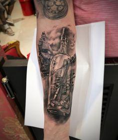 Realism bottle ship tattoo
