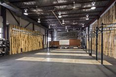 What's the best use for an old garage in an up and coming neighbourhood? That's a no-brainer. A Crossfit gym is the ideal tenant for such a space. Wood accent walls provide an organic feel to the… Crossfit Equipment, Crossfit Box, Gym Plan For Women, Warehouse Gym, Gym For Beginners, Dream Gym, Gym Facilities, Gym Interior, Outdoor Gym