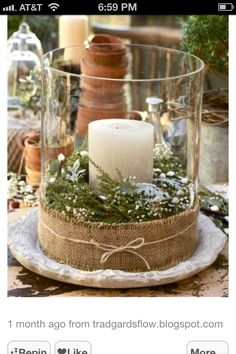 I love burlap! Adding green's, little Christmas balls or pine cones in glass candle holder. Simple.