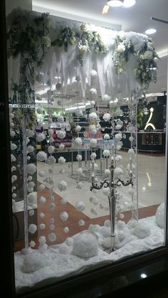 Use cotton padding or felt at the bottom for fake snow also paper icicles for windows<br> Christmas Party Backdrop, Christmas Cubicle Decorations, Christmas Door Decorating Contest, Christmas Window Display, Sticker Vitrine, White Christmas, Christmas Crafts, Winter Wonderland Party, Winter Wonderland Decorations