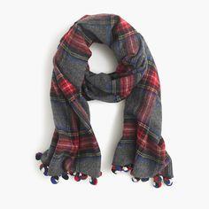"""What's better than a warm and cozy plaid scarf? A warm and cozy plaid scarf with pom-poms. <ul><li>70""""L x 25""""W.</li><li>Wool.</li><li>Dry clean.</li><li>Import.</li></ul>"""