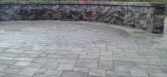 "If you're looking for a cool grey for your patio, Nicolock offers a great color called ""Granite City"". We used it in this patio, and the homeowners LOVE IT!"