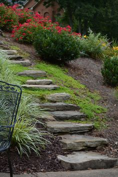 Rustic stone steps are easy to install and offer a much more relaxed feel to a garden.