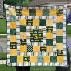 """To paraphrase the Bible wildly out of context with tongue firmly in cheek, """"Greater love has no quilter than to make a rival team quilt. Packers, Quilting, Guy, Blanket, Sewing, Sports, House, Hs Sports, Dressmaking"""