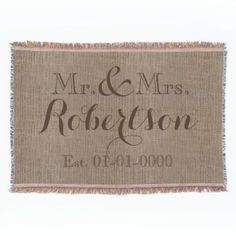 Add your names, wedding date to this one of a kind cherished keepsake blanket. Vintage chic style with the look of a potato sack customized with your very own last name and wedding date. Woven-look printed soft fabric with dark brown custom printing in a wispy swirl and open face font. Great home decor gift for the newlyweds, or as an anniversary gift. Beautiful, woven all-season throw blanket designed for the couch or relaxing on a summer night . Made with wicking technology, poly/cotton…