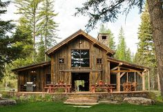 Rustic-modern barn that I need. I would convert the middle living room area into a garage area and a movie theater area while the top would be office space. Oh this is gorgeous.