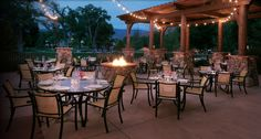 Dine under the stars in Tropitone's La Scala Sling Dining Chairs at Gateway Canyons Resort in Colorado.