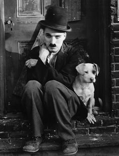 "Charlie Chaplin in the silent movie, ""A Dog's Life"" written, directed, and produced by Charles Spencer Chaplin in 1918."
