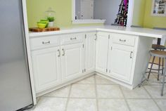 How To Paint Your Cabinets (aka: Hallelujah!) | Young House Love (great tutorial on deglossing and paiting old pine cabinets...also idea for remodel in kitchen-can you say bye bye wall oven and hello island with stove?)