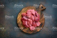 Raw chopped beef on a wooden cutting board.Top view. Стоковые фото Стоковая фотография