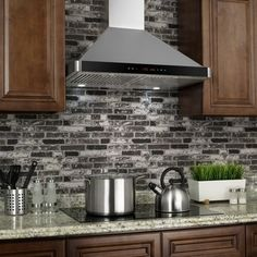 chrome stainless steel vent hood: painted kitchen cabinets: mosaic
