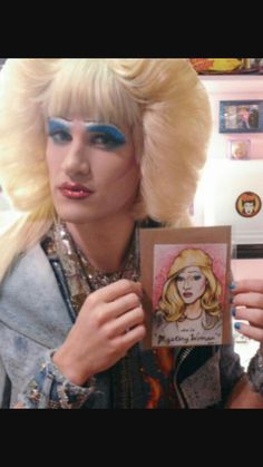 Darren Criss posing with fan art backstage at Hedwig and the Angry Inch