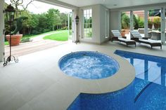 Exterior, Magnificent House With Simple Interior And A Watery Bang: The Expensive Indoor Pool And Jacuzzi In Blue