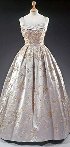 Grey satin gown embroidered with a fern motif in beads and pearls by Hardy Amies. Worn for a state banquet given for the Queen by President Eisenhower at the White House, 1957