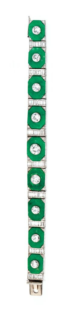PLATINUM, DIAMOND AND JADEITE BRACELET, CIRCA 1925    The tapered band set with carved jadeite segments set in the center with 9 old European-cut diamonds weighing approximately 5.00 carats, spaced by baguette and single-cut diamonds weighing approximately 6.00 carats, length 6 7/8  inches. Estimate: 50,000-70,000 USD