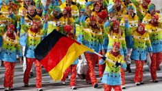 Maria Hoefl-Riesch of Germany carries her country flag as the team arrives during the opening ceremony of the 2014 Winter Olympics in Sochi,...
