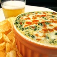 Creamy Cheesy Spinach Dip:   1 tablespoon olive oil, divided  1 small onion, finely chopped  2 cloves garlic, minced  2 (10 ounce) packages frozen spinach -  thawed, drained, and chopped  1/2 cup milk  6 ounces cream cheese  1/2 cup shredded mozzarella cheese  1/4 cup shredded Cheddar cheese  2 dashes Worcestershire sauce  salt and ground black pepper to taste  1/2 cup shredded mozzarella cheese