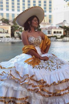 Charro Quinceanera Learn how to plan a traditional charro quinceañera including the perfect dress and decorations to choose so you can have the perfect charro quince theme. Mariachi Quinceanera Dress, Mexican Quinceanera Dresses, Quinceanera Ideas, Quince Dresses Mexican, Charro Dresses, Vestido Charro, Dama Dresses, Bride Dresses, Wedding Dresses