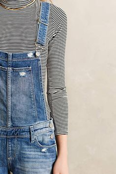 Denim Overalls Paired With A Long Sleeve Striped Top
