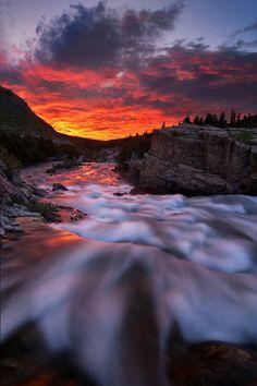 Sunrise, Glacier National Park unfolds along Swiftcurrent Creek