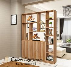 lemari penyekat ruangan model rak ini didesain sebagai penyekat ruangan yang multifungsi, karena bisa dipakai untuk tempat menyimpan barang-barang sekaligus untuk menaruh hiasan rumah agar lebih rapi