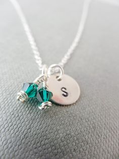Birthstone initial necklace Emerald Swarovski crystal for May birthdays. Personalise with a silver monogram charm for the perfect unique gift by SilverZoo