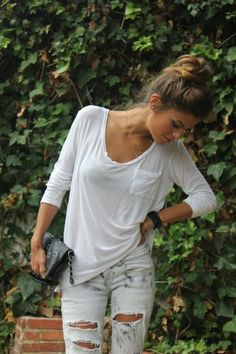 loose white tee + ripped light jeans + clutch
