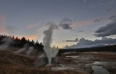 The sun sets over Norris Geyser Basin in Yellowstone National Park.
