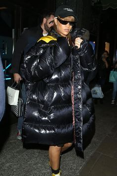 Rihanna in a Raf Simons oversized sexy puffer coat