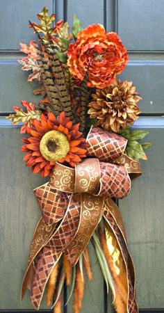 Fall Wreath, Autumn Wreath, Sunflower Swag Bouquet with Pheasant Feathers. via Etsy. Feather Bouquet, Feather Wreath, Champagne And Red Wedding, Wedding Dress With Feathers, Rustic Bridal Bouquets, Fall Swags, Burlap Roses, Pheasant Feathers, Autumn Decorating