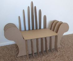 DIY Cardboard Chair, Super cute for a toddler or children.  This can also be made in adult size and is super super sturdy.