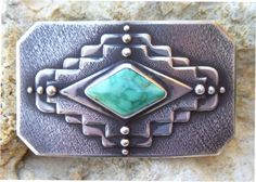 """Sterling silver overlay belt buckle in a stylized """"Ojo de Dios"""" (eye of God) motif which is common as a center piece in Mexican Saltillo serapes and s"""