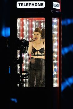 """Kiesza performs """"Hideaway"""" in a telephone booth onstage at the 2014 MTV EMA's on November 9, 2014 in Glasgow, Scotland."""