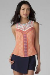 La Brea Embroidered Tank The La Brea Embroidered Tank is a special piece you have to have in your closet! This structured silhouette boasts a unique embroidery pattern all over the front with a chiffon panel in the back