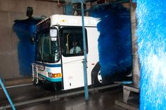 It takes a super-sized car wash to clean the buses. all Detroit Transit buses NEED this so bad they are BLACK