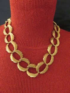 Racing links in gold create a stunning Napier choker necklace offering versatility to style for casual wear or special occasions.
