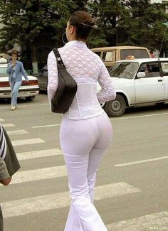 What do you see in this picture?  - For young men, it's a nice rear end. The really observant will see the thong;  - For older men, it's a respectable woman with a nice rear end crossing the street;  - Wise men will ponder the presence of mind of the photographer in the face of  such beauty, and have gratitude that it was shared with humanity;  - For half of the women, this is an ordinary woman who should not have  left home dressed that way;  - The other half is wondering where she bought…