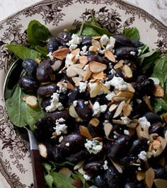 Black Bean Salad: Black beans and toasted almonds tossed with a honey-jalapeno-lime dressing served over arugula and finished with a bit of feta. #MeatlessMonday