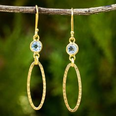 NOVICA 24k Gold Plate on Sterling Silver Earrings with Blue Topaz (€36) ❤ liked on Polyvore featuring jewelry, earrings, blue, dangle, 24k earrings, blue dangle earrings, diamond earrings, long dangle earrings and blue topaz dangle earrings