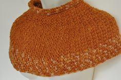 Crocheted poncho in handspun burnt orange wool