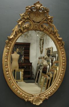 Mirrors:  Old French Napoleon III large, double-crested oval mirror.