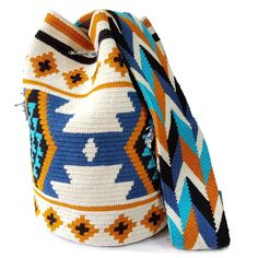 The stunning, one-of-a-kind, double thread Wayuu bag is 100% handmade and has been carefully crocheted by women from the Wayuu tribe in La Guajira, Colombia.This beautiful Wayuu bag that you are seeing was carefully crafted using a double thread technique.This versatile Wayuu bag is perfect for a night out, running errands, hiking, relax on the weekend, or to take to the gym.This piece represents approximately 10-15 days of work for a single artisan.