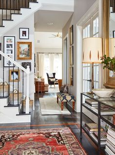 Stylist Natalie Nassar's Atlanta home has a narrow entry that she's outfitted with a narrow entry console and an oversized mirror