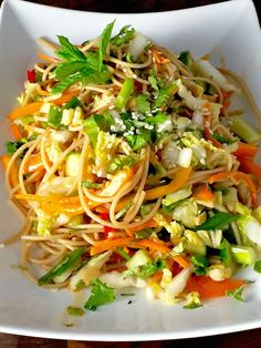 Asian Noodle Salad - A recipe for delicious cold noodles, loaded with veggies, slicked with sauce and pumped up with lots of garlic, ginger and sesame.  Yes please. - theoptimalistkitchen.com
