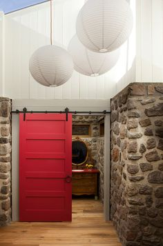 Red Sliding Barn Door downstairs exercise room barn door style but with black hardware