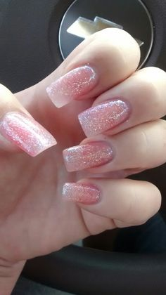 "Fresh set of acrylic nails with clear pink and glitter from Kiara Sky""Iceberg"" love these neutral sparkly nails"