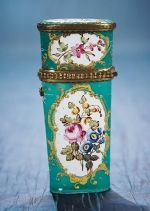"""EARLY ENAMELED ETUI WITH FLORAL SCENES 3 1/2"""" (8 cm.) Of rectangular shape with slightly-tapered base and rounded edges,the metal gilded frame necessaire has rich enamel finish decorated with four different colorful floral arrangements,each within a scrolled cartouche. The case hinges open at the gilt metal frame for access to the hollow interior. Early 19th century."""