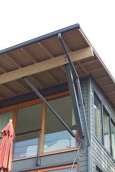 I don't like all the supports, but it's probably a realistic structural design. Also, finally gutters on the lower slope of a overhang roof...(ugly but practical, rain chains instead?) Dislike the material colors.  Umbrella House by David Neiman Architects, http://www.neimanarchitects.com/Umbrella-home.htm